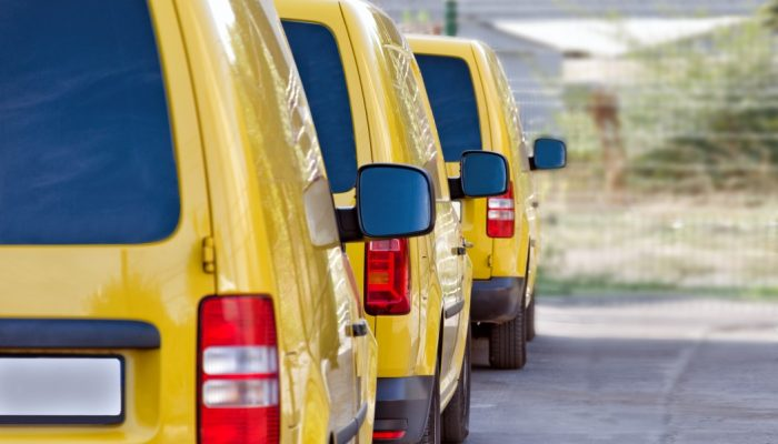 yellow-courier-or-taxi-cars-are-lined-up-in-the-parking-lot_t20_pxjJdW